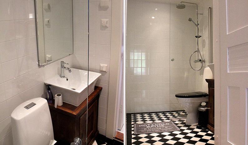 Kylpyhuoneista tehtiin mustavalkoiset ja talon henkeen sopivat