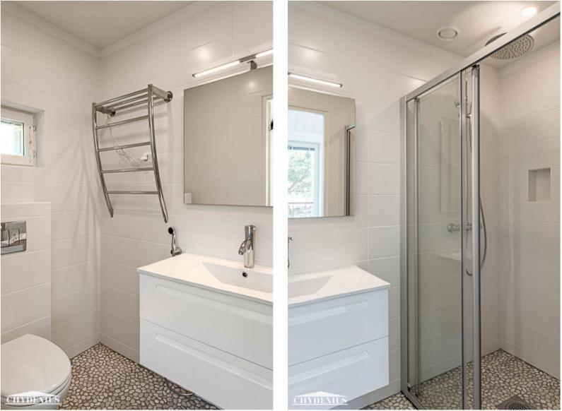 Kylpyhuoneissa saa kävellä rantakivillä